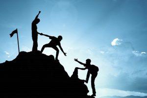 climbing-helping-team-work-success-concept 53089-101-2